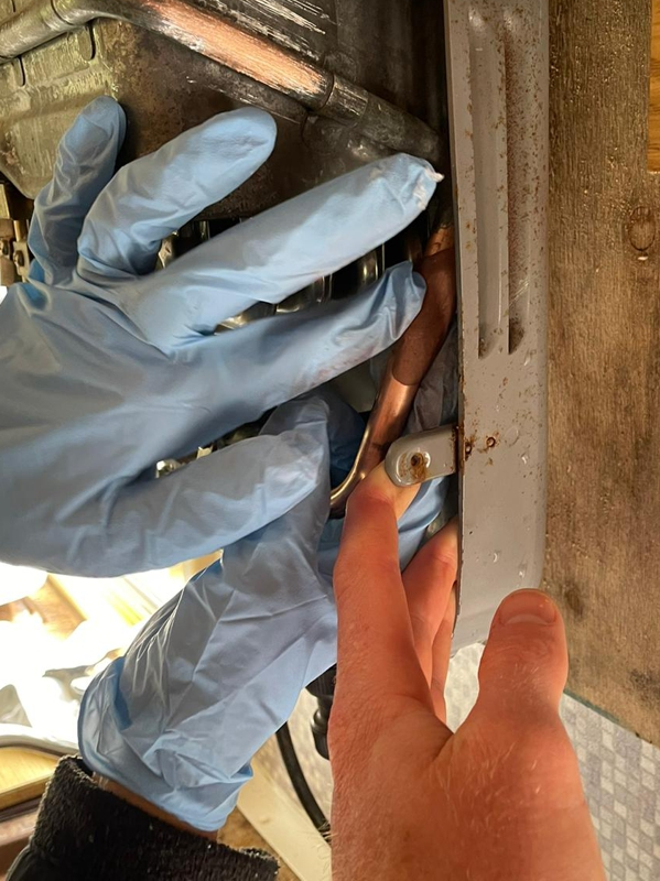 Superfast Copper Epoxy Putty being applied to repair a crack in a pipe which formed part of a camper van boiler system