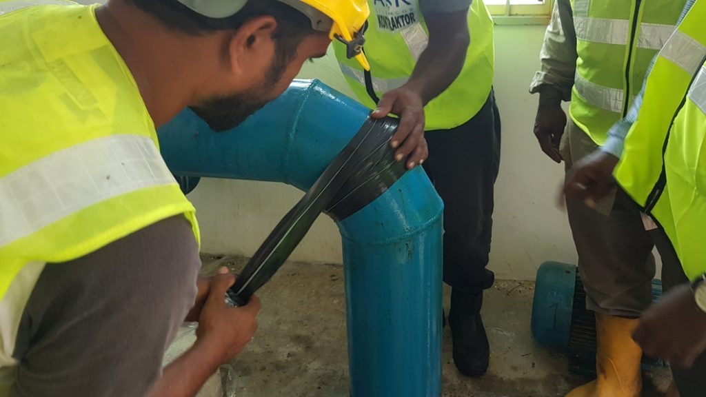 Wrap & Seal Pioe Burst Tape used to repair a pinhole leak on a 150mm pipe elbow in Malaysia
