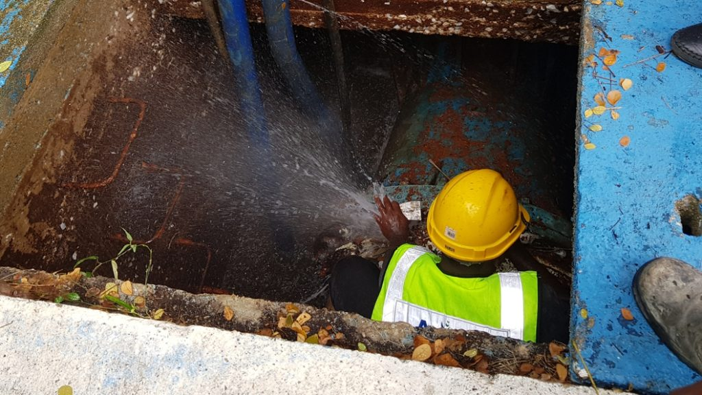 Water escaping a 900mm underground water main in Malaysia prior to undergoing a Sylmasta repair